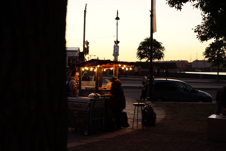 Rear view of man on street at sunset