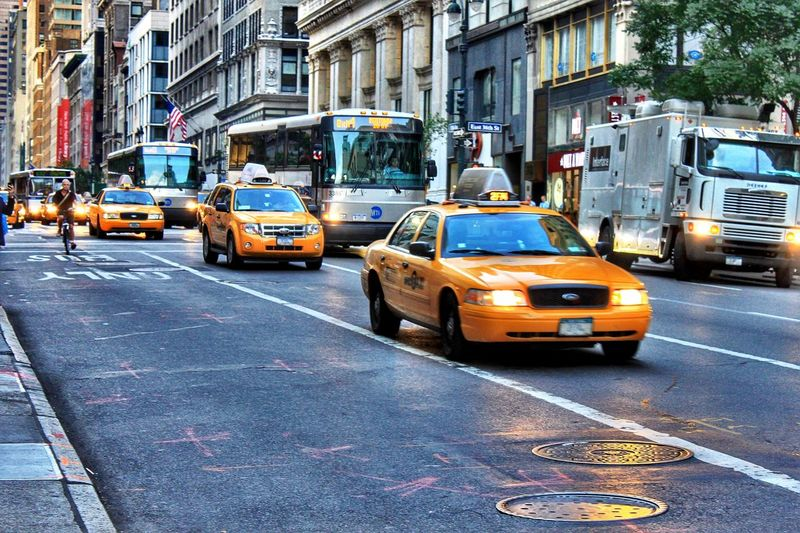 New York City Travel New York City New York Mode Of Transportation Transportation Car City Motor Vehicle Architecture Land Vehicle Street Building Exterior Road Taxi Yellow Taxi City Life Traffic City Street Day