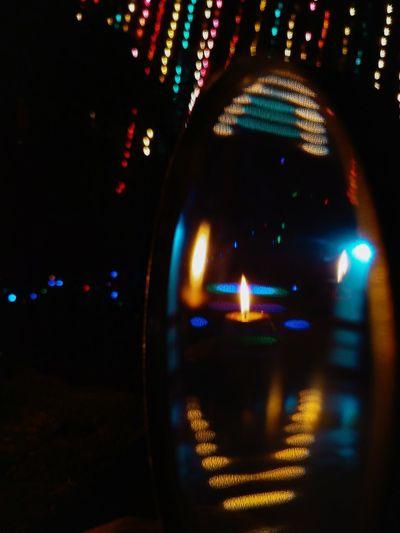 Defocused image of illuminated city street at night