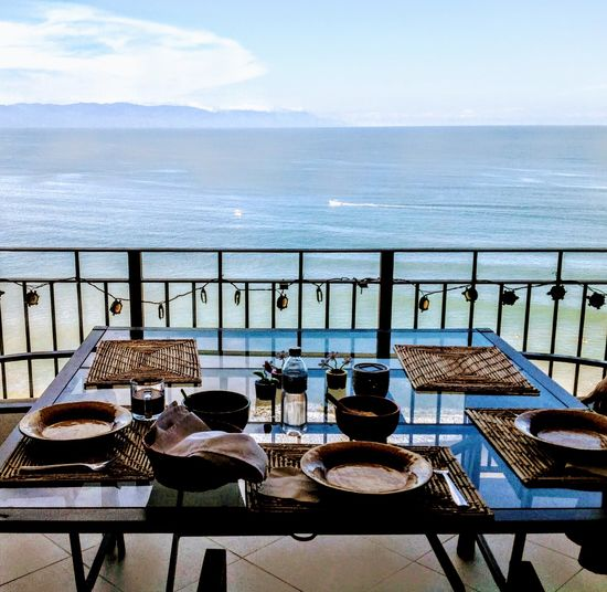 View from our balcony in Puerto Vallarta Selected For Premium. Selected For Premium Mountain Ocean View Pacific Ocean Patio Waves, Ocean, Nature View From Patio View From Above Puerto Vallarta Puerto Vallarta, México Puerto Vallarta Jalisco Mexico Patio Furniture Dinner Time Dinnertime Inviting Atmosphere Tranquility Travel Destinations Ocean Horizon Over Water Mexico Day Outdoors Table Dining Table