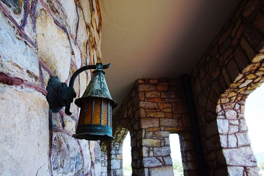 EyeEm Selects Architecture Built Structure Low Angle View No People Building Exterior Indoors  Porch Lamp Lantern Rock Wall Textures And Surfaces Textured  Passageway