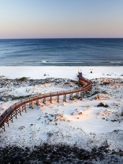 View of the Beach with Wooden Walkway, Beach and Gulf Waters 1 Water Sea Sky Horizon Horizon Over Water Scenics - Nature Beauty In Nature Tranquility Tranquil Scene Nature Clear Sky Beach Winter Land Cold Temperature No People Day Snow Idyllic Outdoors