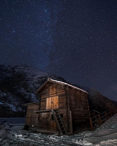 Hut against starlit sky