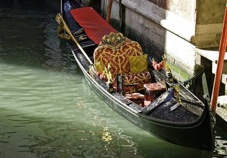 The gondola is a traditional, flat-bottomed Venetian rowing boat, well suited to the conditions of the Venetian lagoon. It is similar to a canoe but narrower and propelled by a gondolier Canoe Gondola Narrow Romantic Transport Transportation Typical Venetian Attraction Boat Canal Culture Daylight Flat Gondolier Historical Italian Italy Old Picturesque Sea Traditional Venice Water Wooden