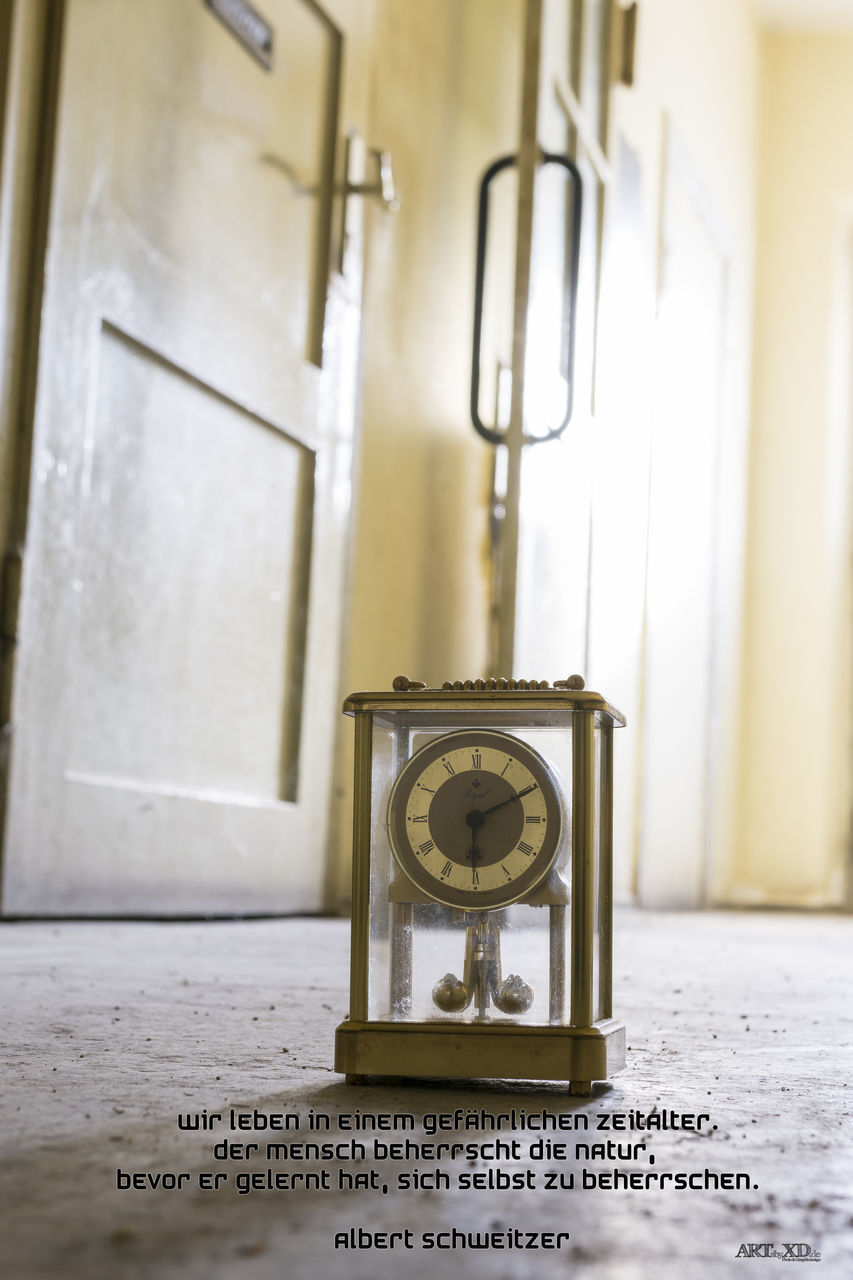 time, clock, indoors, no people, number, communication, still life, close-up, table, instrument of time, accuracy, text, single object, day, metal, wall - building feature, technology, selective focus, western script, clock face, minute hand