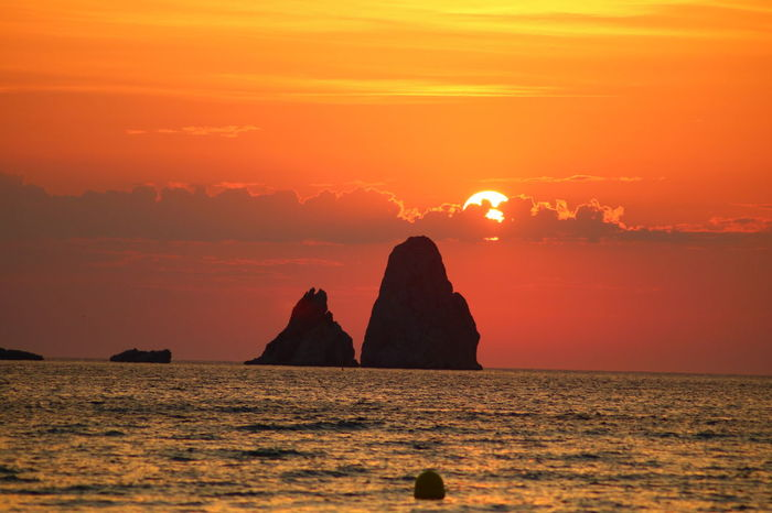 EyeEm Selects Water Environment Sky Sunset Beauty In Nature Nature Landscape Sea Solid Rock Rock - Object Land Tranquility Scenics - Nature Travel Destinations Sun Travel No People Tranquil Scene Orange Color