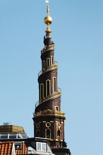 Tower Of A Great Nation Sealand Amager Real Gold Top Gold Coated Snail Tower Snail Structure Towers Of Copenhagen On The Way Up Many People Architecture Building Exterior Built Structure Sky Building Tower Go Higher Clear Sky Low Angle View Nature Place Of Worship Travel Destinations Tall - High Religion The Past History Belief Blue Spire  Day