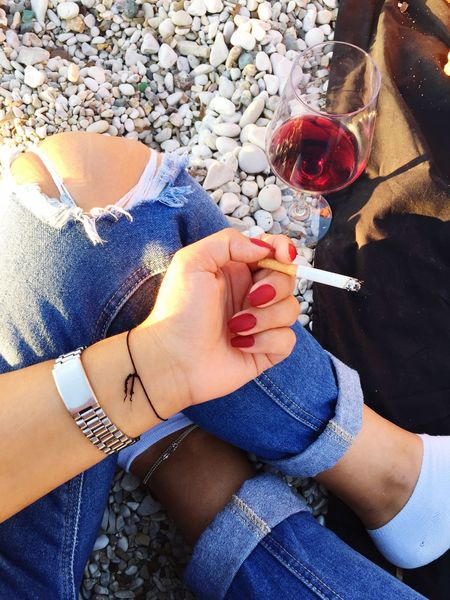 Sunset Women Cigarette  Real People Wine Two People Women High Angle View Jeans Togetherness Casual Clothing Lifestyles Wineglass Holding Human Body Part Human Hand Drink