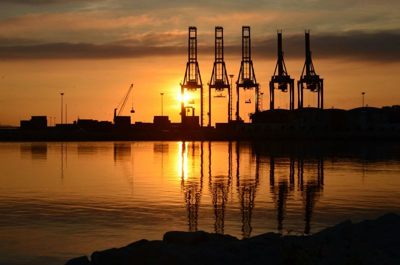 Port of Malaga in the morning - Malaga - Andalucia, Spain Sunrise Crane Cranes Morning Morning Light Malaga SPAIN Andalucía Andalusia Porto Andaluzia Seaside Mar Background Reflection Silhouette Business Finance And Industry Cloud - Sky Water No People Industry Outdoors Sky Sun Gold Colored Sea Harbor Commercial Dock Urban Skyline City Colour Your Horizn