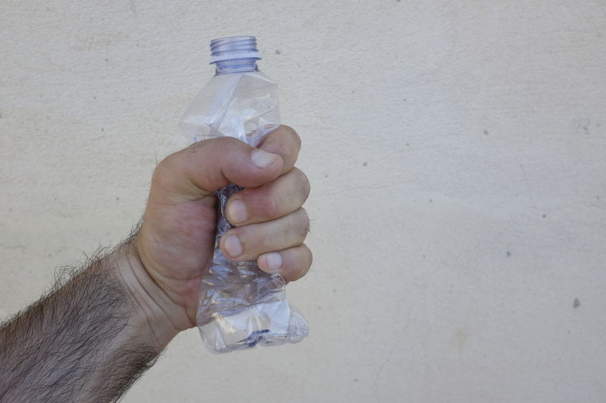 Bottle Close-up Cold Drink Concept Crush Crushed Day Drinking Water Holding Human Body Part Human Hand One Person Outdoors People Plastic Plastic Bottle Real People Recycling Squeeze Water Water Bottle