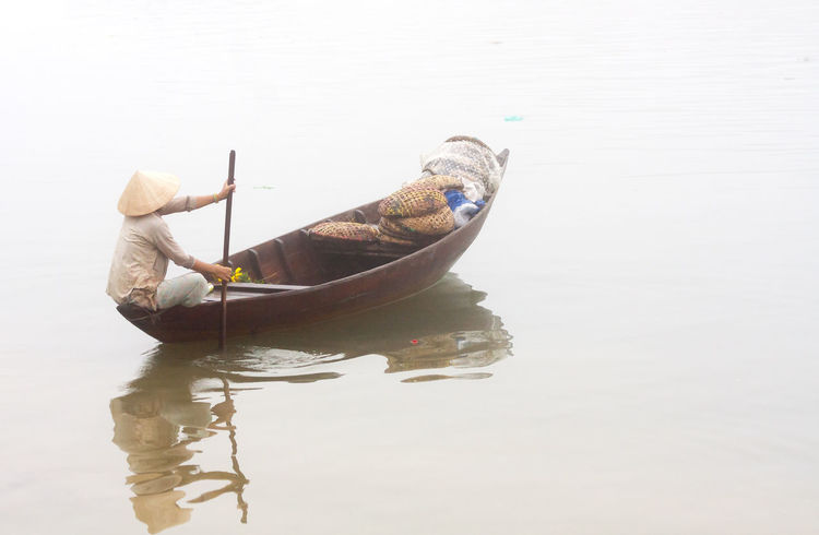 Woman paddling boat on the river Boat,co Day First Eyeem Photo Hanging Out Hoi An Misty Nature No People Outdoors River Vietnam Water