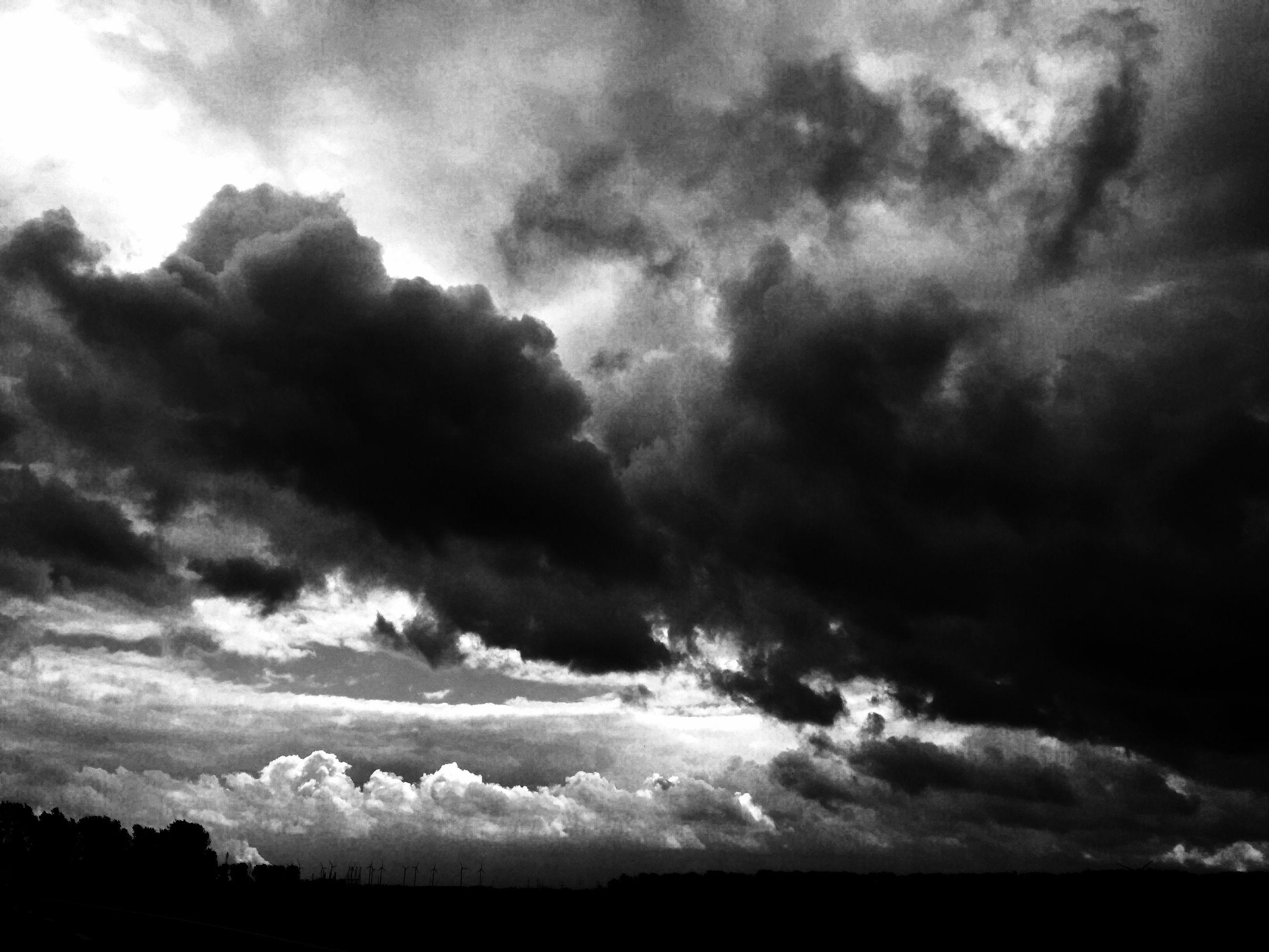 sky, tranquil scene, cloud - sky, tranquility, cloudy, scenics, beauty in nature, landscape, nature, cloud, weather, silhouette, overcast, cloudscape, storm cloud, idyllic, dramatic sky, field, dusk, non-urban scene