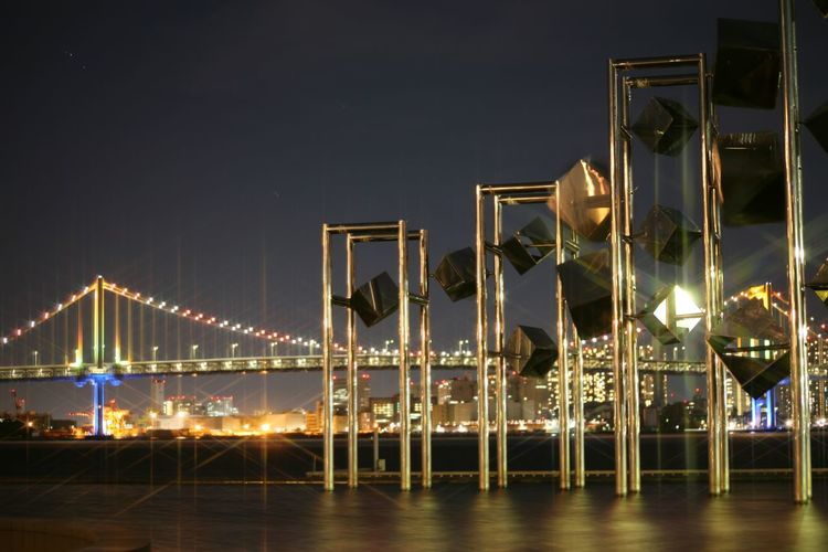 Modern Sculptures In Front Of Bridge