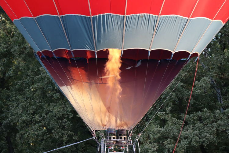 Hot air balloon flying against sky