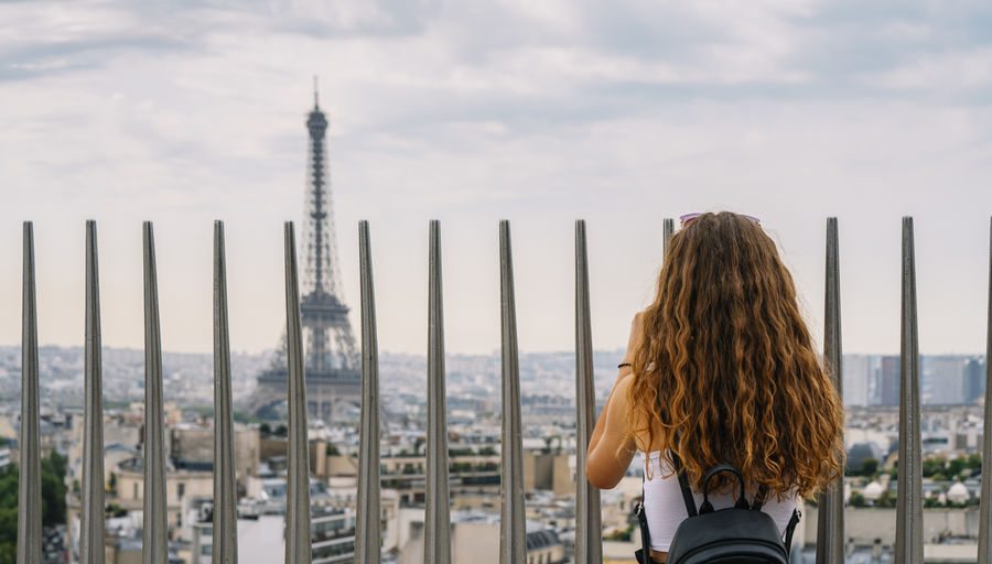 Rear view of woman looking at eiffel tower