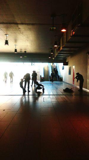 View of illuminated people in corridor