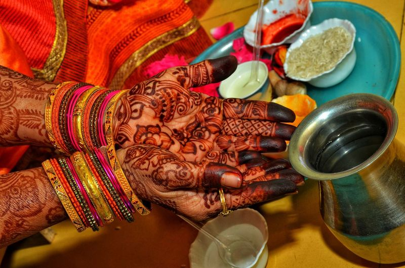 Indian Pooja Human Hand Bride Women Cultures High Angle View Close-up Wedding Ceremony Wedding Dress Wedding Ring Wedding Vows Wedding Guest Engagement Ring Life Events Sari Wedding Groom Bangle Henna Tattoo Newlywed Ceremony Bridegroom Veil Bridesmaid