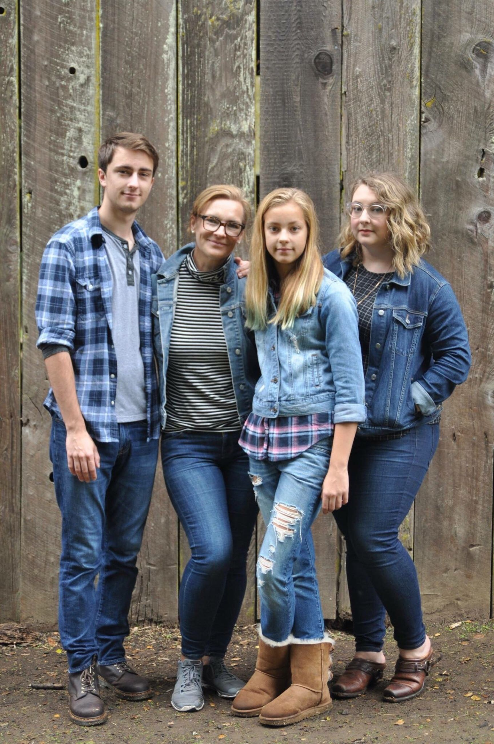 casual clothing, young adult, jeans, young women, day, standing, togetherness, young men, friendship, full length, front view, hands in pockets, outdoors, bonding, leisure activity, looking at camera, portrait, group of people, men, blond hair, people, adult, adults only