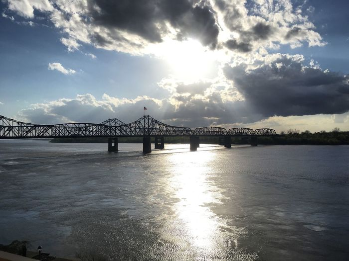 Mississippi River Water Sky Bridge - Man Made Structure Sunlight Cloud - Sky Architecture Built Structure Sea Beauty In Nature Outdoors Transportation Travel Destinations Scenics No People Nature Day Sun Suspension Bridge City