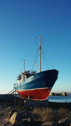 Low angle view of ship moored against sky