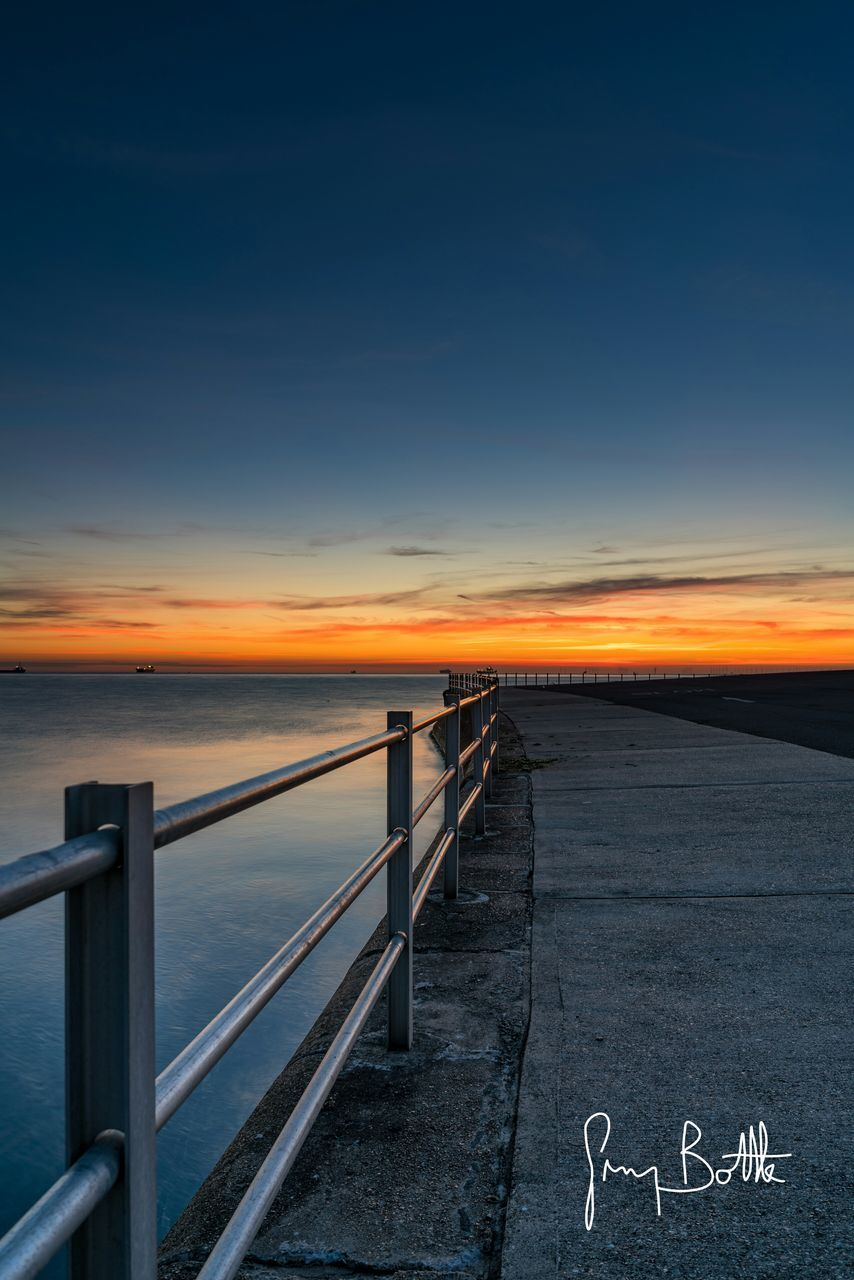 sunset, nature, sky, railing, tranquil scene, scenics, beauty in nature, sea, water, outdoors, horizon over water, tranquility, no people, day