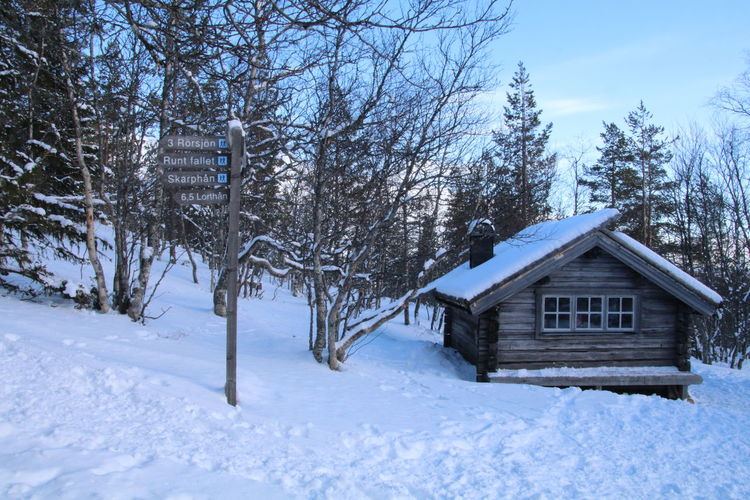 Architecture Cottage Njupeskär In Sweden. Outdoors Snow Walk In The National Park Winter