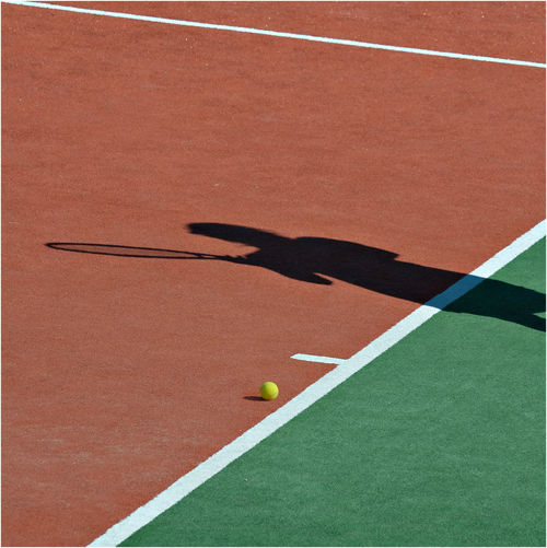 Shadow of person at tennis court