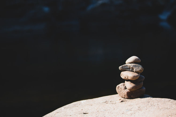 Solid Rock Rock - Object No People Balance Close-up Nature Stack Focus On Foreground Copy Space Stone - Object Sunlight Day Zen-like Outdoors Shell Beauty In Nature Studio Shot Land Still Life Black Background Pebble