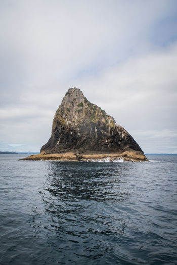 shark fin shaped rock at the bay of islands Travel Beauty In Nature Cloud - Sky Eroded Horizon Horizon Over Water Idyllic Marine Nature New Zealand No People Outdoors Pacific Ocean Rock Rock - Object Rock Formation Scenics - Nature Sea Sky Solid Stack Rock Tranquil Scene Tranquility Water Waterfront The Great Outdoors - 2018 EyeEm Awards