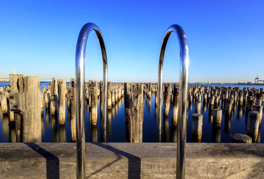 Princes pier in the day Pier Architecture Blue Built Structure Clear Sky Day Horizon In A Row Metal Nature No People Outdoors Princes Pier Scenics - Nature Sea Security Shadow Sky Travel Destinations Water Wood - Material Wooden Post