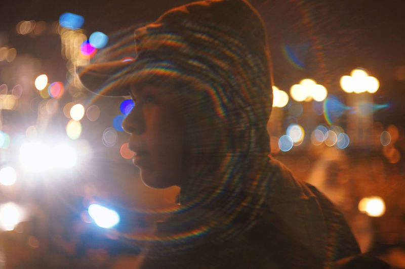Close-up Defocused Focus On Foreground Headshot Illuminated Leisure Activity Lens Flare Lifestyles Lighting Equipment Men Night Nightlife One Person Outdoors People Real People Side View Women Young Adult