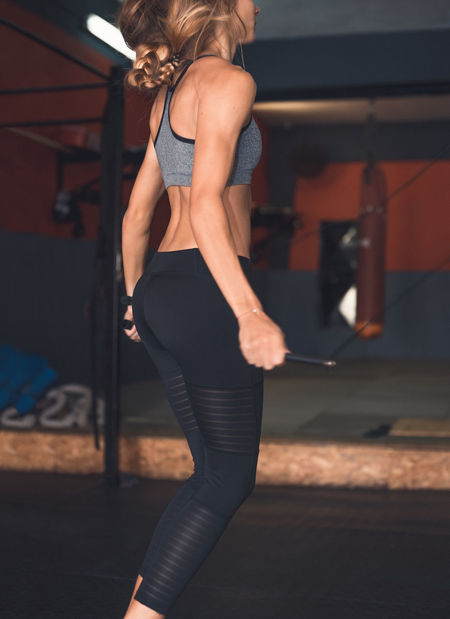 Exercising Indoor Activities Musculation  Squat Beautiful Woman Blonde Exercising Cross Training Crossfit Crossfit Girl Energy Fit Jumping Jumping Rope Kettlebell  Lifestyles Muscular Build One Person Real People Rear View Sport Clothing Stretching Training Weightlifting Workout Young Women