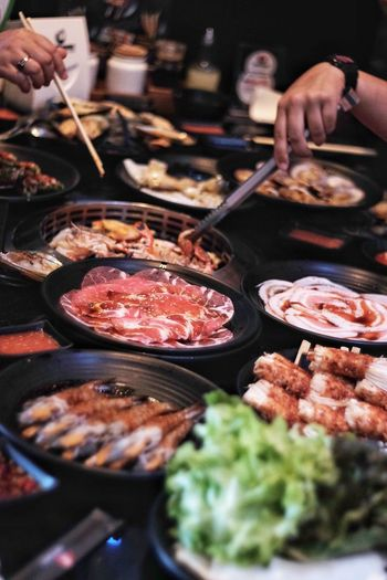 Grilled food is popular. EyeEm Selects Meat Gourmet Preparation  Close-up Food And Drink Street Food Asian Food Thai Food Asian Culture Soy Sauce Chinese Takeout Stir-fried Street Market Barbecue Grill Fish Market Deep Fried  Market Vendor Concession Stand Skewer Market Stall Fried For Sale Stall Curry