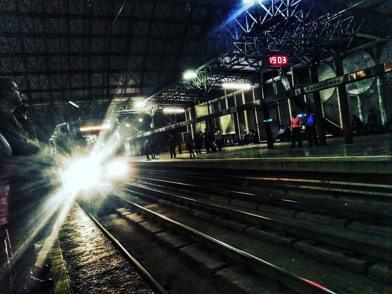 railroad track, rail transportation, transportation, illuminated, public transportation, railroad station platform, night, railroad station, railway track, real people, outdoors, built structure, architecture