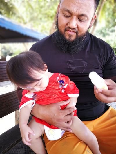 Pulau Redang, Terengganu, Malaysia. Real People Males  Parent Family Family With One Child Child Men Females Front View Togetherness Father Childhood Three Quarter Length Women Lifestyles Mid Adult Holding Son Daughter Positive Emotion Innocence