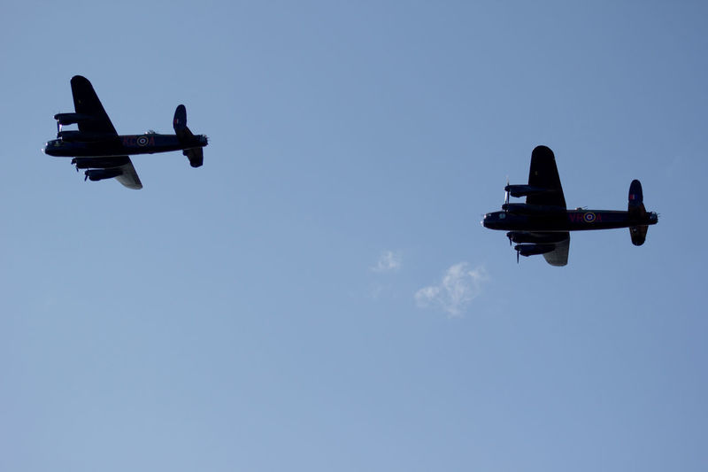 The only 2 flying Lancaster Bombers Air Vehicle Airplane Airshow Blue Clear Sky Copy Space Day Fighter Plane Flying Journey Lancaster Bomber Low Angle View Military Military Airplane Mode Of Transport No People Outdoors Plane Sky Transportation