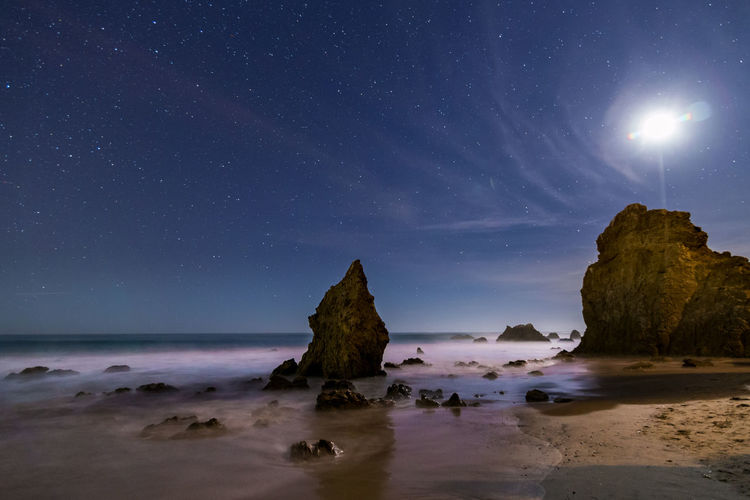 Scenic view of sea at night