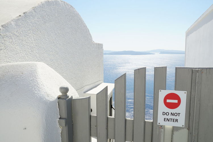 Paradise is closed today Gate Locked Mediterranean  Access Denied Architecture Built Structure Close-up Closed Day Door Horizon Over Water Kyklades Nature No Access No People Outdoors Paradise Santorini Sea Secluded  Sky Sunlight Water White Color Whitewashed