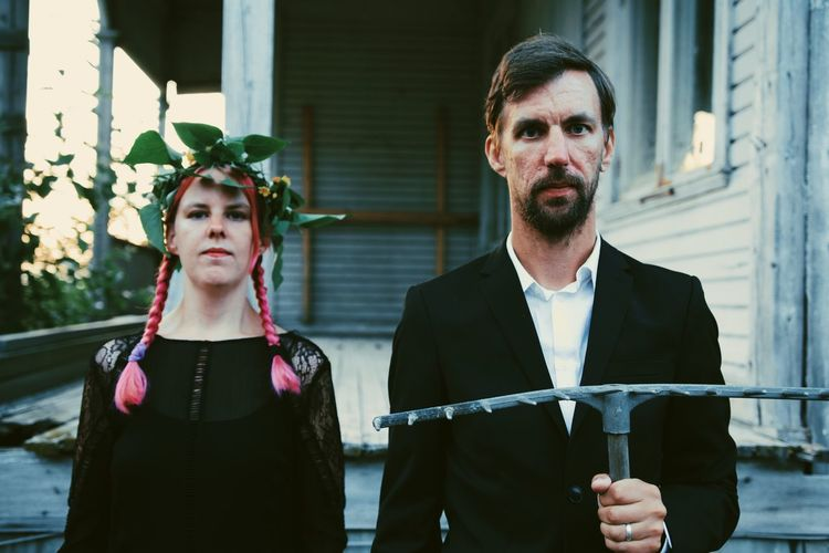 Portrait of serious couple standing outdoors