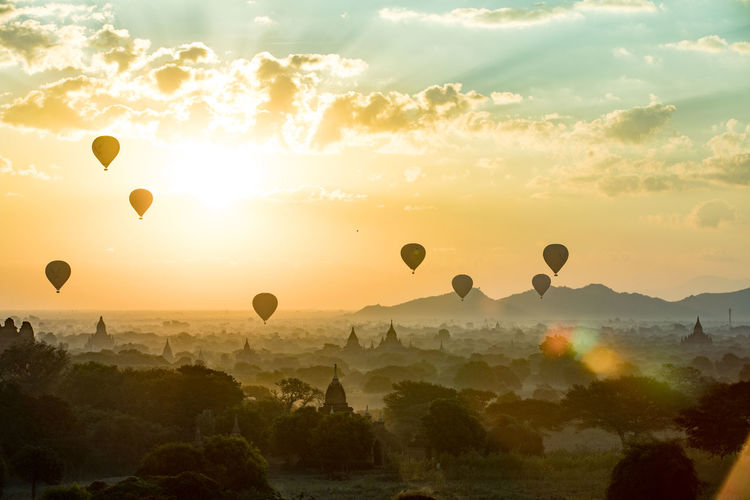 Air Vehicle Architecture Balloon Ballooning Festival Beauty In Nature Cloud - Sky Environment Flying Hot Air Balloon Landscape Mid-air Nature No People Orange Color Outdoors Scenics - Nature Sky Sun Sunset Tranquil Scene Transportation