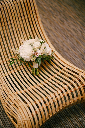 High angle view of white flowering plant in basket