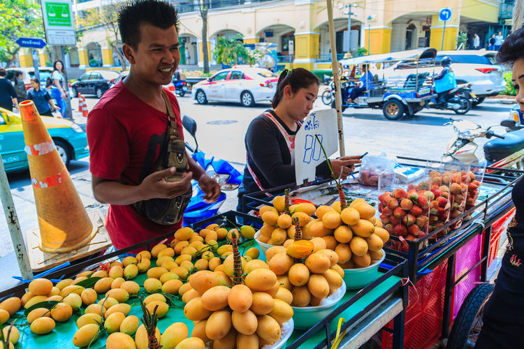 Bangkok, Thailand - March 2, 2017: Plango fruit vendor in Bangkok, Plango fruit or Marian Plum, famous tropical fruit in Thailand. Sweet Maprang or Mayongchid (Bouae bumanica Griff) Bouae Bumanica Bouae Bumanica Griff MaYongChit Mayongchid Fruit Plango Plango Fruit Plango Thai Tropical Fruits Adult Business Buying Casual Clothing Choice Food Food And Drink For Sale Freshness Fruit Healthy Eating Incidental People Maprang Marian Plum Market Market Stall Men Orange Outdoors People Real People Retail  Retail Display Small Business Wellbeing Women