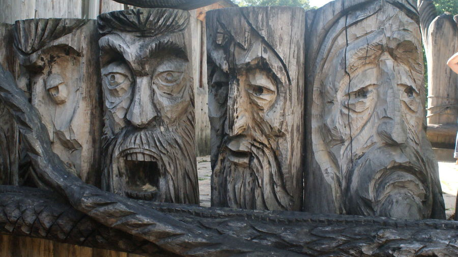 Sculpture of faces Architecture Art And Craft History Outdoors Sculpture Statue