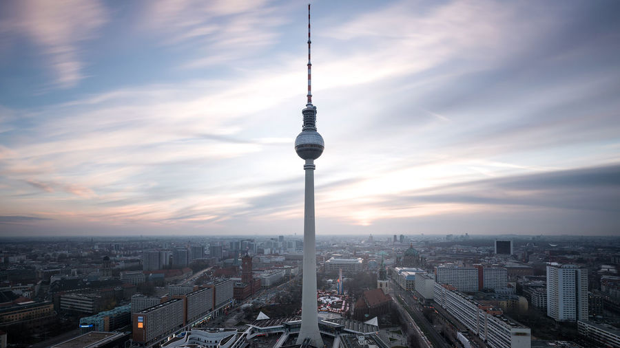 Fernsehturm In City Against Sky During Sunset