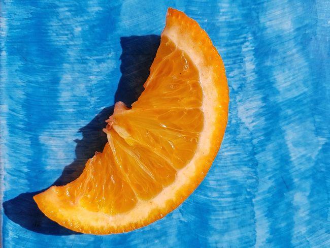EyeEm Selects Blue SLICE Healthy Eating Close-up Freshness Orange Orange Orange Fruit Blue Background Contrasting Colors Fruit Slice Summer Fresh Fruit Citrus Fruit