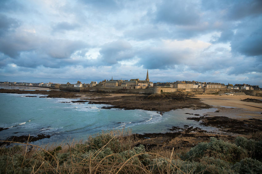 A view on the fortress of Saint-Malo from Grand Bé island Atlantic Ocean Bretagne Brittany City Wall Cloudy English Channel France Panoramic View Saint-Malo Beach Blue Cloud - Sky Coast Corsair City Fortress Ille-et-vilaine Low Tide Medieval No People Overcast Port Sea Sky Tranquility Water
