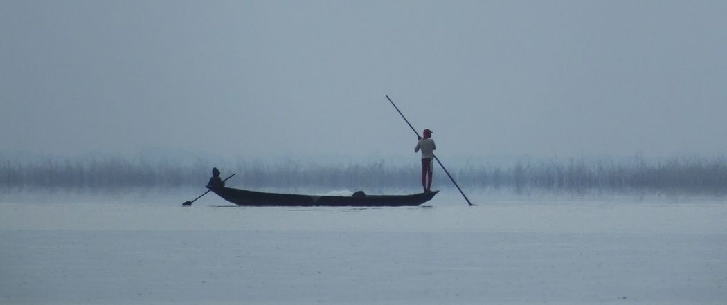 This picture was taken on lake Nokoué in Bénin as we were crossing in a small boat from Ganvié to reach Porto-Novo. Boat On Lake Fisherman Fog Lake Non-urban Scene Scenics - Nature Tranquil Scene Tranquility Water