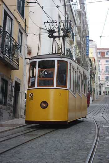 Bica Building Exterior Cable Car City Life City Street Incidental People Land Vehicle Lisboa Lisbon Mode Of Transport Public Transport Public Transportation Street The Way Forward Train Tram Tramway Transportation Urban