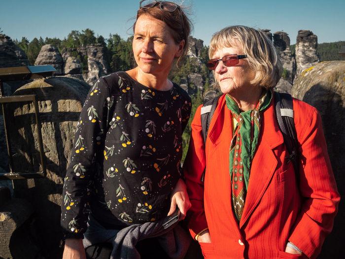 Women standing in front of old ruin