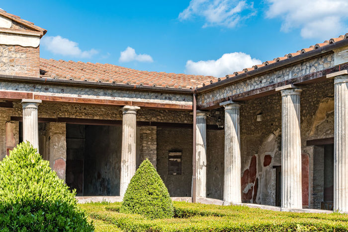 Architectural detail in Pompei, Italy. A house in the archeological excavations of Pompei, Italy. Painted Plants Pompeii  Roof The Graphic City Travel Archeological Architectural Column Architectural Detail Architecture Blue Building Exterior Built Structure Cloud - Sky Day Detail Europe Excavation Grass History House Italy Nature No People Outdoors
